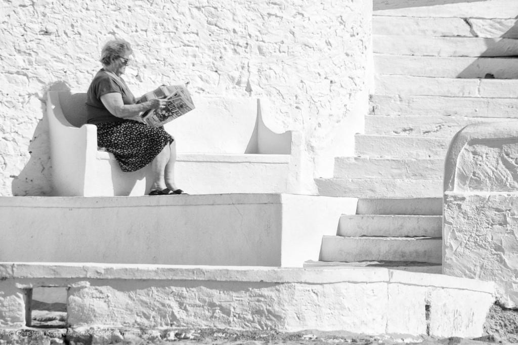 Reading the news (Algarve, Portugal)